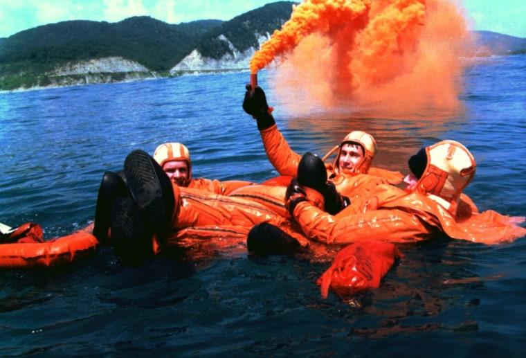 Members of the first International Space Station crew, including Russian cosmonauts Yuri Gidzenko and Sergei Krikalev plus NASA astronaut Bill Shepherd, practice water survival skills in the Black Sea in 1997.
