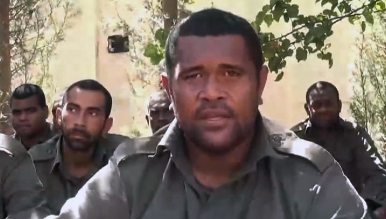 Image: Fijian UN peacekeeper sitting with other UN hostages