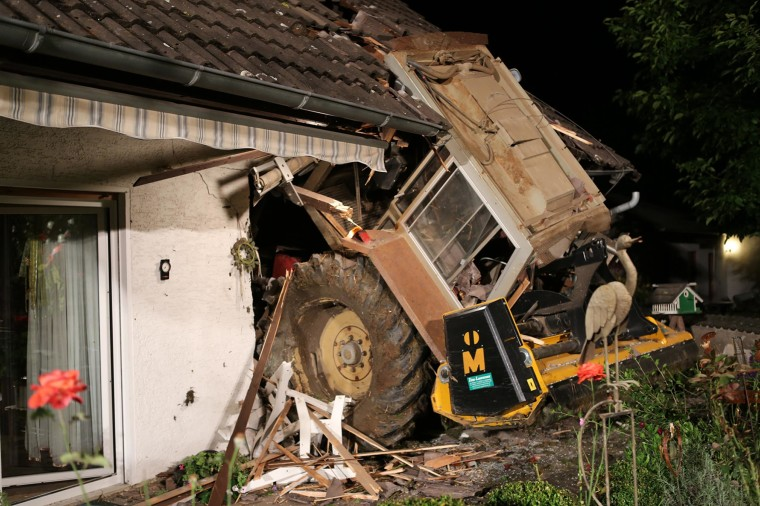 A 6-ton tractor that smashed into the bedroom of a family home near Homberg, Germany.
