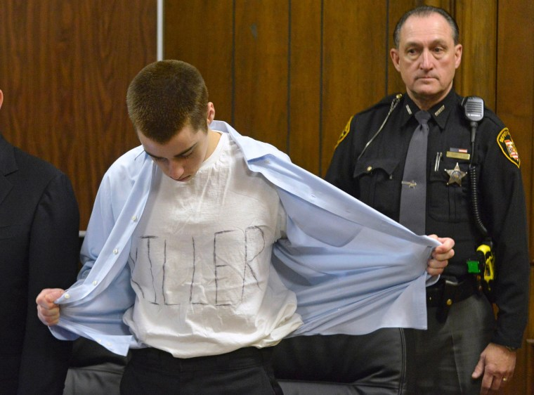"Image: Lane shows his t-shirt with the words ""Killer"" at his sentencing in Cleveland"