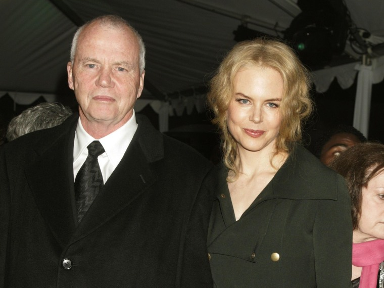 Actress Nicole Kidman is escorted by her father, Dr. Antony Kidman, as she arrives at the 2005 Palm Springs Film Festival Gala dinner in Palm Springs, California in this January 8, 2005 file photo. Dr. Kidman was pronounced dead at Singapore's Tan Tock Seng Hospital early September 12, 2014, police said.