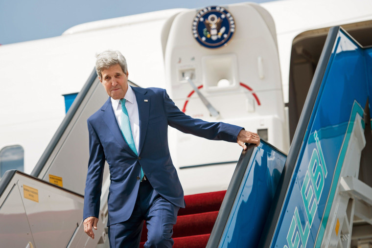 US Secretary of State John Kerry arrives at Ankara International Airport on September 12, 2014. Kerry is in the region to speak with leaders about strategies to address the threat from ISIS. Secretary of State John Kerry said on September 12 that the US would provide an additional $500 million in humanitarian aid to victims of the war in Syria, bringing total American assistance to $2.9 billion since the start of the conflict in 2011. AFP PHOTO/POOL / BRENDAN SMIALOWSKIBRENDAN SMIALOWSKI/AFP/Getty Images