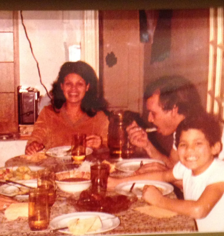 Chris with his parents, Braudelina and Joaquín, in 1982.