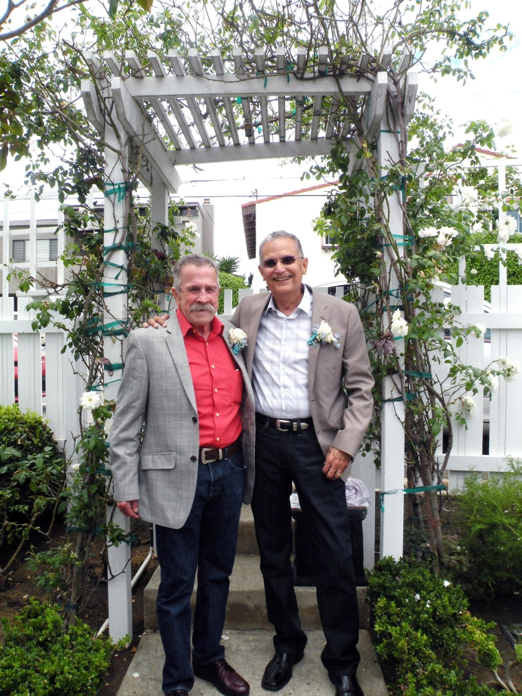 Fred McQuire, left, and George Martinez pose for photos at their wedding in California.