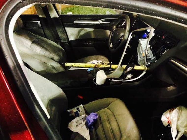 A car struck a gate and part of the gate penetrated the car and impaled the driver near the stadium at Hopewell High School in North Carolina. The yellow pole is seen here.