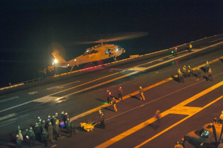 Image: A MH-60S Sea Hawk helicopter lands on the flight deck of the Nimitz-class aircraft carrier USS Carl Vinson
