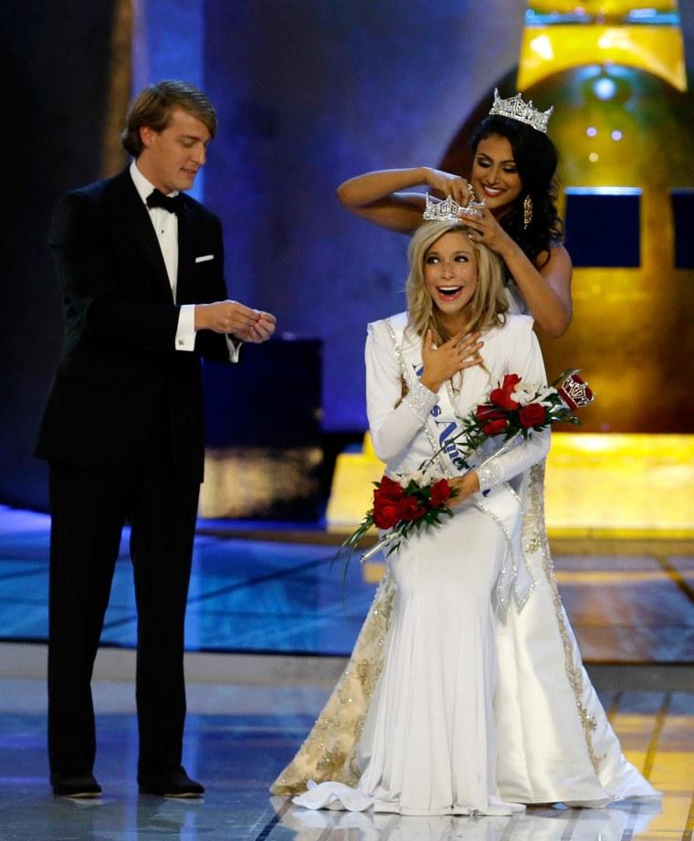 Image: Miss America 2014 Nina Davuluri, top right, crowns Miss New York Kira Kazantsev as Miss America 2015