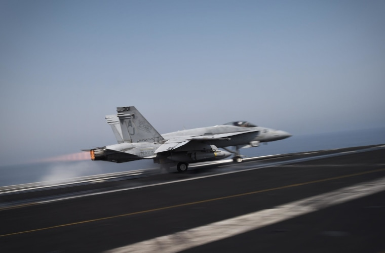Image: An F/A-18C Hornet takes off for Iraq