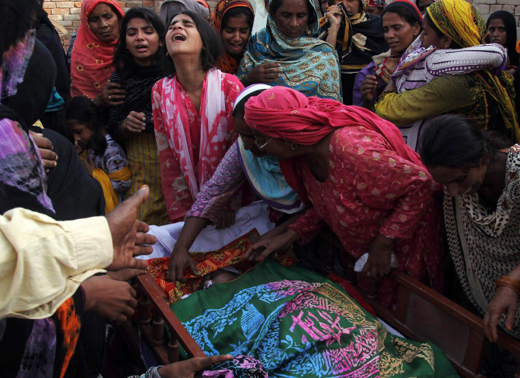 Image: Relatives mourn after boat capsizes in Multan, Pakistan
