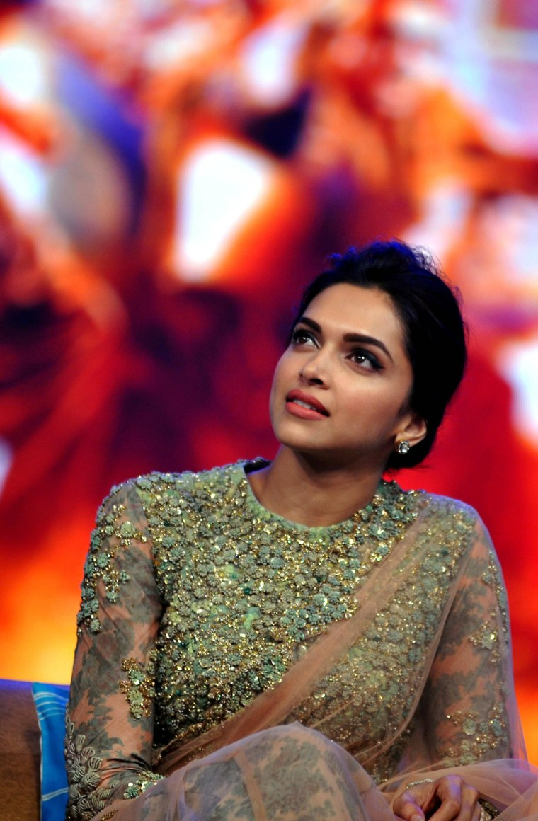 Image: Indian Bollywood actress Deepika Padukone looks on during a promotional event for the forthcoming Hindi film 'Happy New Year' on Sept. 15.