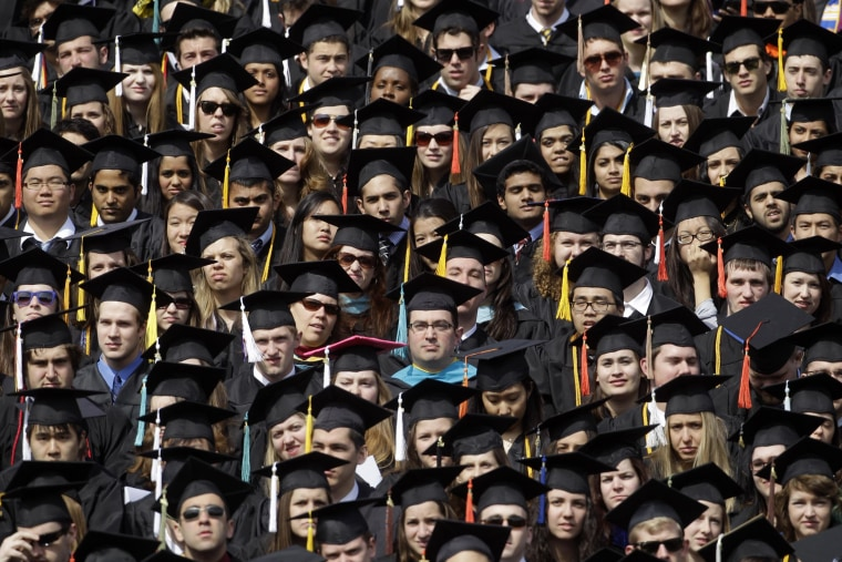 Image: Graduates listen as Michigan Gov. Rick Snyder delivers his address at the University of Michigan commencement ceremony at Michigan Stadium in Ann Arbor, Mich