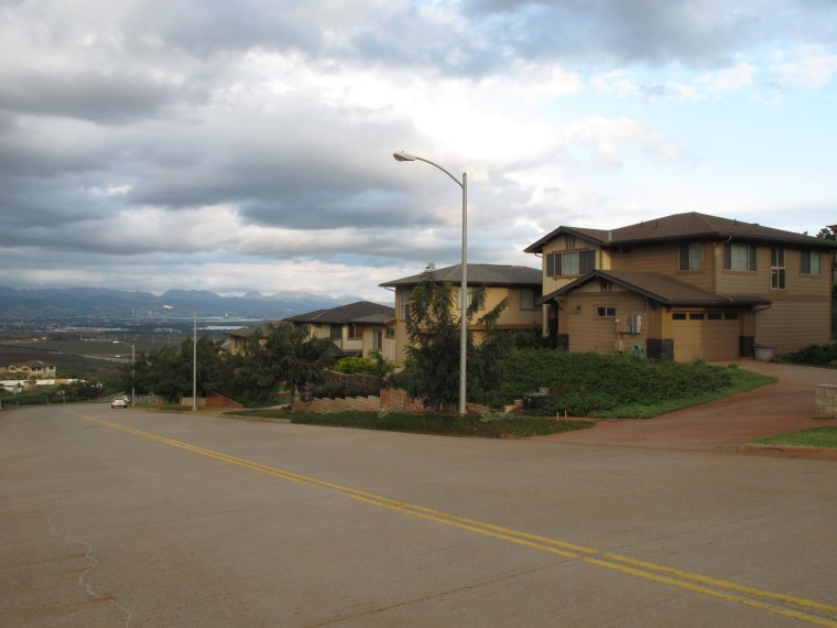 Image: The home, right, of civilian defense contractor Benjamin Pierce Bishop in Kapolei, Hawaii