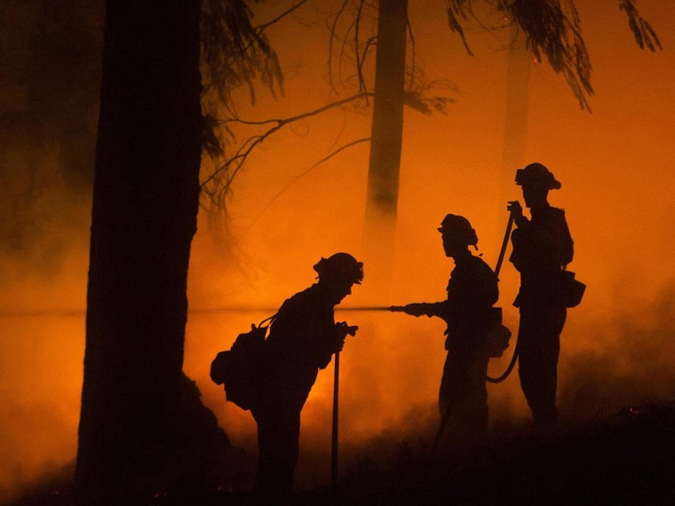 Image: Firefighters battle the King Fire in Fresh Pond, California