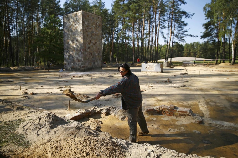 Image: Archeologist and historian Zalewska digs inside the perimeter of a Nazi death camp in Sobibor