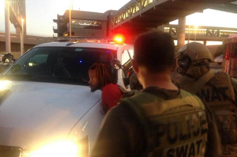 Image: A suspect has been arrested after a part of the Phoenix airport was on lockdown for several hours Thursday as police sought one of two suspects in a shooting in nearby Tempe