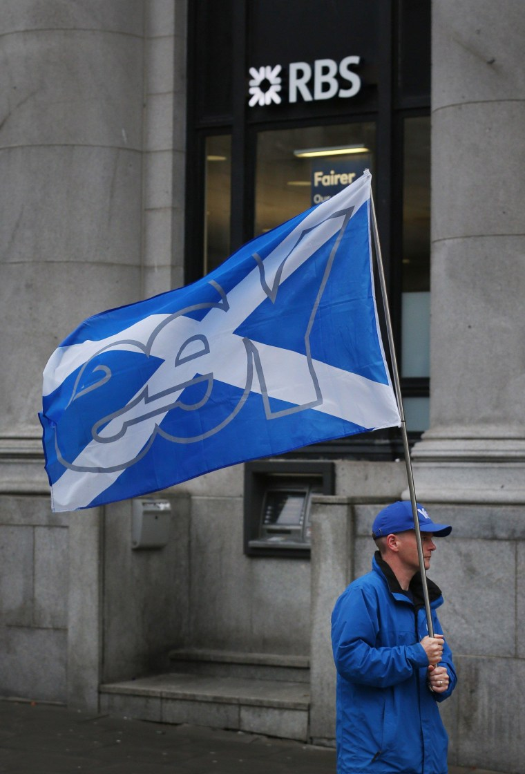 Image: A pro-independece campaigner outside a Royal Bank of Scotland branch in Aberdeen on Monday
