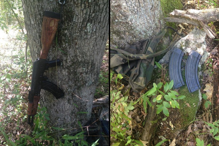 Image: An AK-47 style assault rifle, left, along with ammunition, were discovered in the Pennsylvania woods and are believed to belong to Eric Frein, who was being hunted in connection with the fatal shooting of a state trooper.