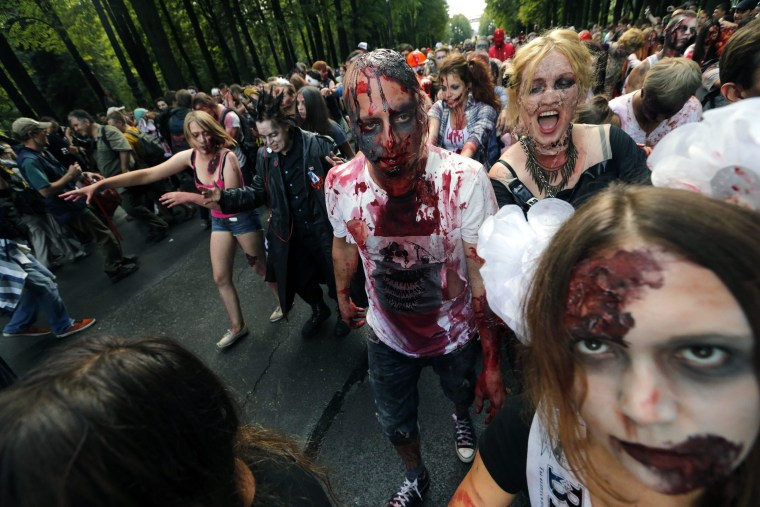 epa04356558 People costumed as ghouls and zombies gather at a Zombie flash mob in central park of St.Petersburg, Russia, 16 August 2014. The Zombie flash mob refers to the worldwide annual events of the 'Zombie Walk' where people dress up as zombies. The Zombie Walk was originated in the USA and took place for the first time in Sacramento in 2001.  EPA/ANATOLY MALTSEV