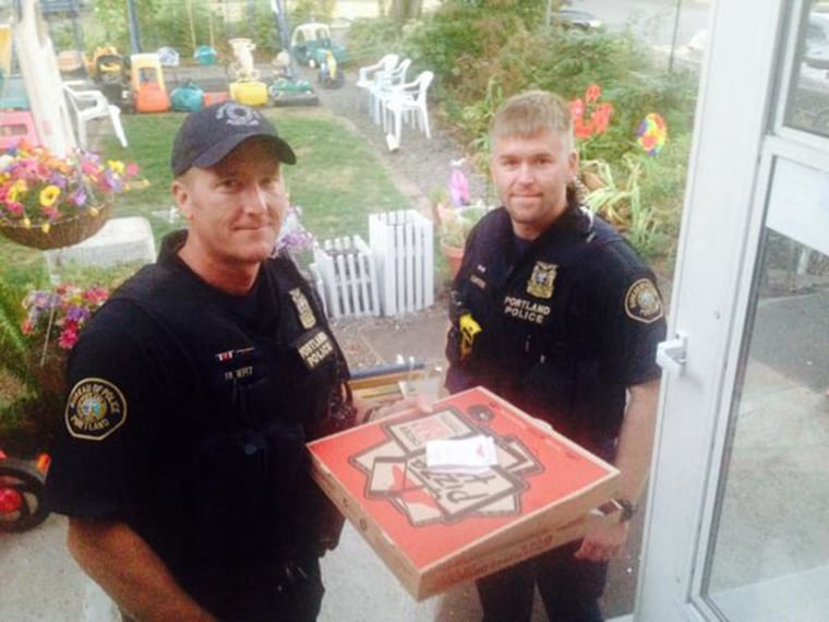 Image: Officers Filbert and Curtiss deliver a pizza in Portland
