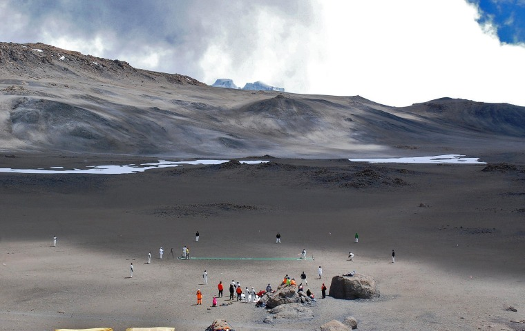 Image: Cricketers play on the ice-covered crater of the Kilimanjaro mountain