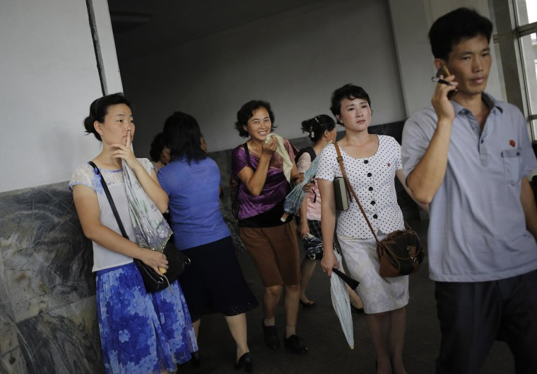 Image: North Koreans leave an underground subway station in Pyongyang,