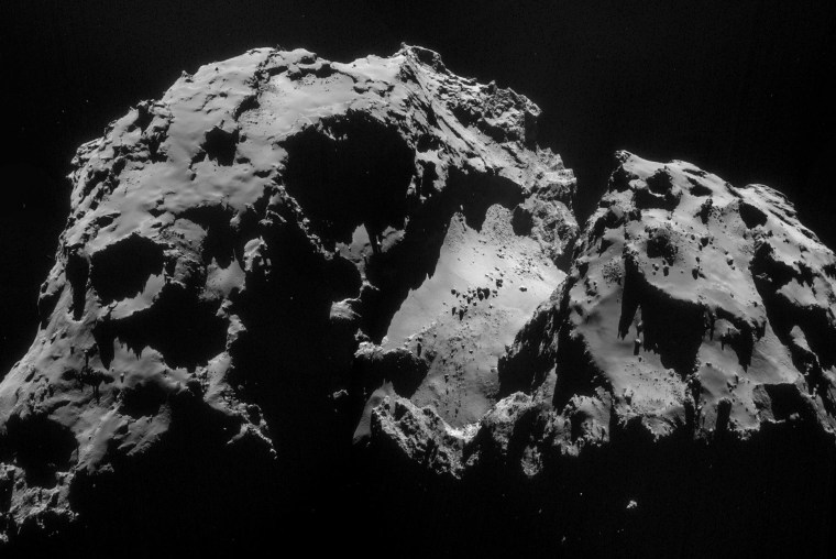 """A mosaic of four images from the Rosetta spacecraft's Navcam imager, acquired on Sept. 24, shows a section of Comet 67P/Churasimov-Gerasimenko. Boulders that measure several yards (meters) across can be seen lying in a smooth region of the comet's """"neck."""""""