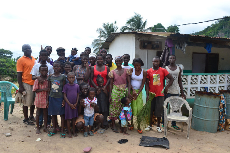Cocoa farmer Justice Obini's family and friends in Burko, Ghana.