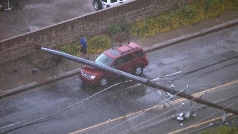 Image: A telephone pole fell on a car after a strong storm moved through Phoenix.