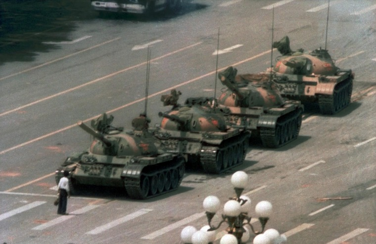 Image: A Chinese man stands alone to block a line of tanks heading east on Beijing's Cangan Blvd. in Tiananmen Square on June 5, 1989.