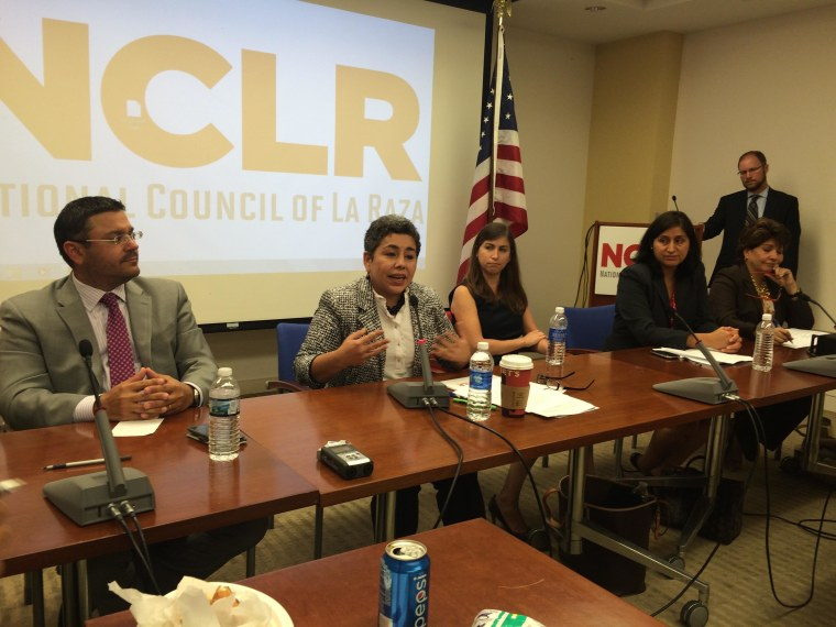 Clarissa Martinez De Castro, a deputy vice president at National Council of La Raza, (center) discusses Latino voter turnout prospects in 2014 with other panelists in a news conference Monday, Sept. 29, 2014.