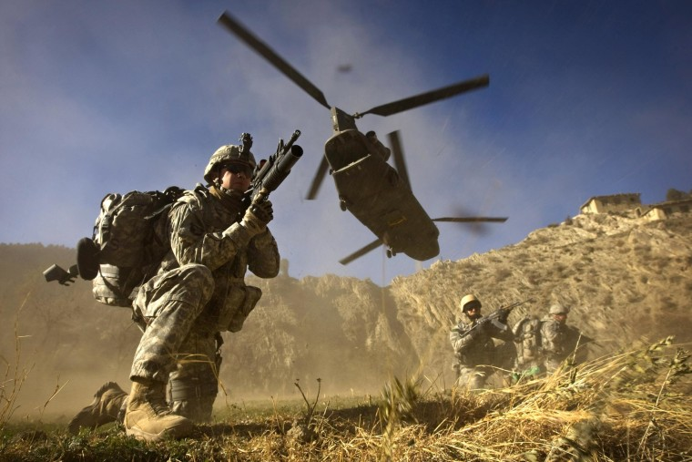 Image: U.S. soldiers take position after leaving a Chinook helicopter in Afghanistan