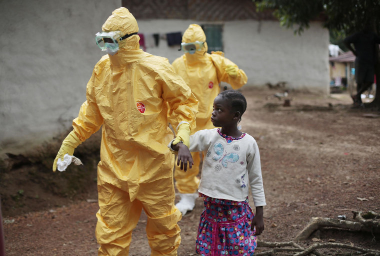 Nowa Paye, 9, is taken to an ambulance after showing signs of the Ebola infection in the village of Freeman Reserve, about 30 miles north of Monrovia, Liberia, on Sept. 30.