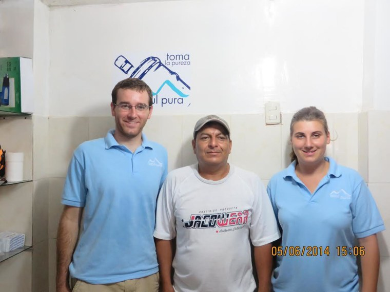James Golden (left) Billy Castro (center), franchisee of the water treatment center in Puná, and Marie Chaffard-Luçon, a Water Ecuador volunteer from France.