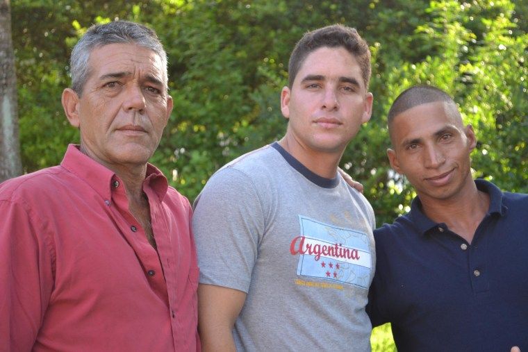 Jose Ramon Fuente Lastre, 23, at center, recently made the treacherous journey from Cuba to Florida along with his father, Antonio Cardenas Viejo, at left, and Yennier Martinez Diaz, 31, at right.