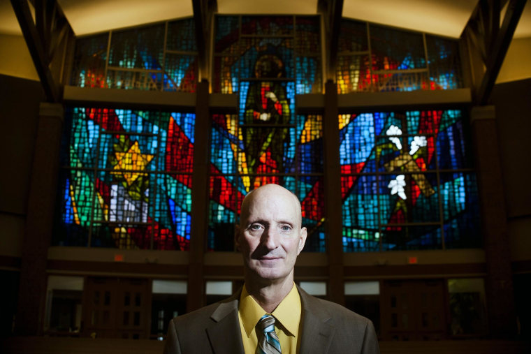Image:  Michael Mencer, 58, stands for a portrait inside St. Joseph Catholic Church  in Lincoln, NE.