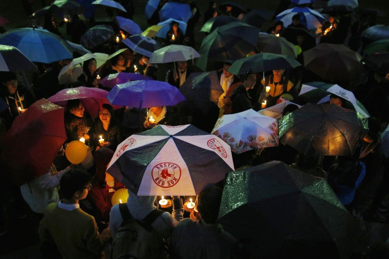 Image: People hold candles and umbrellas during a demonstration in support of the pro-democracy protestors in Hong Kong, in Boston, Massachusetts