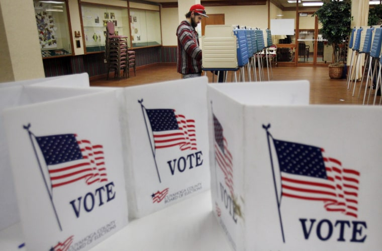 A voter casts his ballot at a polling site in the 2012 US presidential election in Cleveland, Ohio, USA, 06 November 2012.