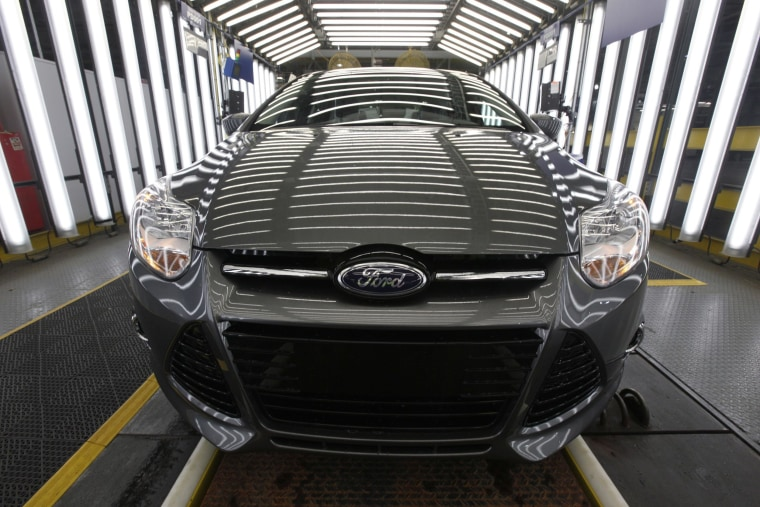 Image: A 2012 Ford Focus on the assembly line at the Ford Michigan Assembly plant