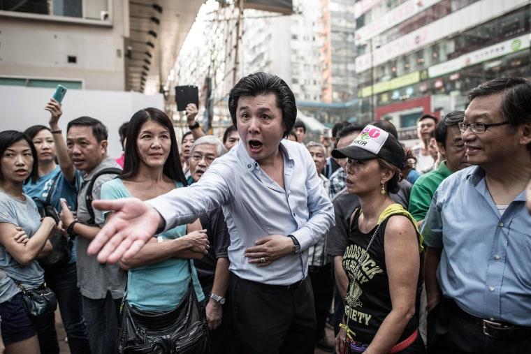 Image: An anti protester shouts at a pro-democracy demonstrator in an occupied area of Hong Kong