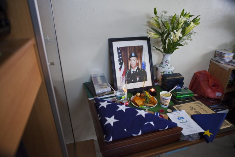 Image: A shrine for Pvt. Danny Chen at his home in the Manhattan borough of New York on Friday, December 30, 2011.