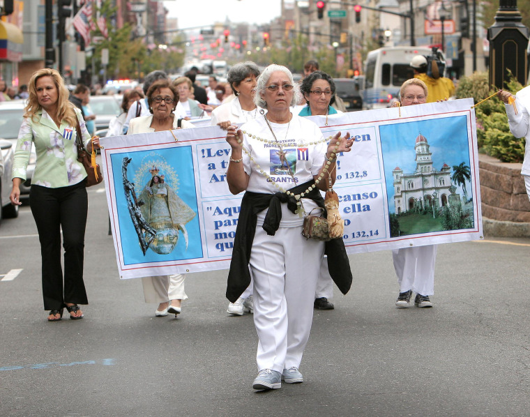 Eumelia Quiros, 70, of West New York, New Jersey walks in Union City, New Jersey's traditional procession honoring Cuba's patron saint on Sept. 12, 2010.