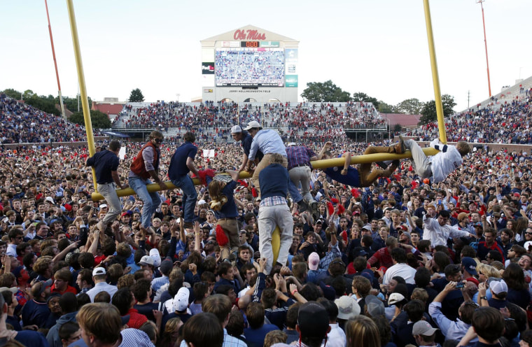 Image: Mississippi fans gather on the field, as some clamber onto a goal post, after Mississippi defeated Alabama 23-17 in an NCAA college football game in Oxford, Miss., on Oct. 4.