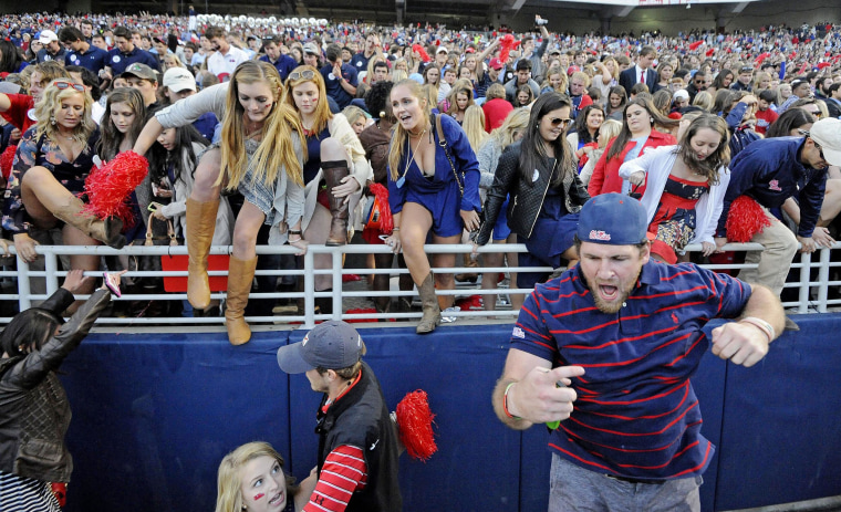 Image: Mississippi fans rush the field after an NCAA college football game in Oxford, Miss., on Oct. 4. No. 11 Mississippi beat No. 3 Alabama 23-17.