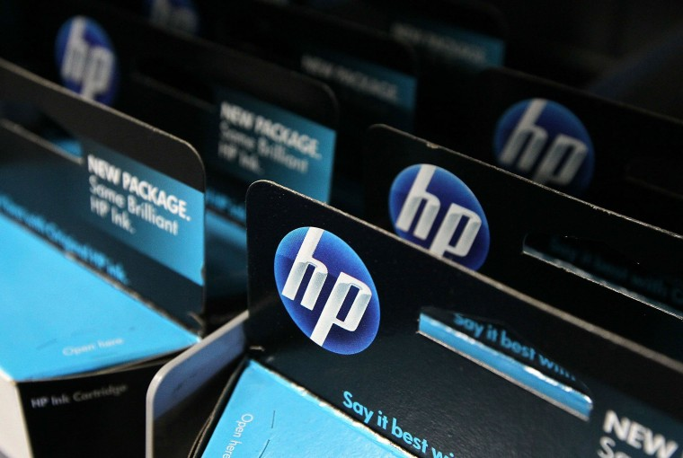 Packages of HP ink cartridges ares displayed at a Best Buy store June 1, 2010, in San Francisco, Calif.. Hewlett-Packard Co. announced today that they plan to cut 9,000 jobs over several years as they invest $1 billion to automate data centers and make operational changes.