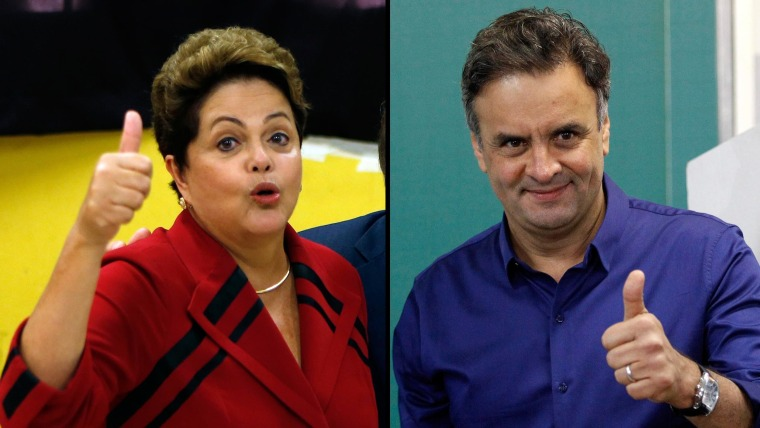 A combination photo shows presidential candidates President Dilma Rousseff (L) of the Workers' Party and Aecio Neves of the Brazilian Social Democracy Party gesturing to photographers after voting at their respective voting stations in Porto Alegre (L) and Belo Horizonte on Oct. 5, 2014.  Brazil's presidential election is going to a runoff between Rousseff and challenger Neves, the country's electoral authority confirmed on Sunday.
