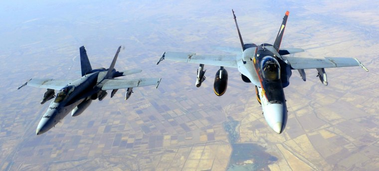 "This October 4, 2014 US Navy handout image shows two US Navy F-18E Super Hornets supporting operations against IS, after being refueled by a KC-135 Statotanker over Iraq after conducting an airstrike.  The US military unleashed a wave of air strikes against Islamic State jihadists in Syria and Iraq this weekend, destroying tanks, armored vehicles and mortar teams, a statement said October 5. AFP PHOTO / HANDOUT / US AIR FORCE / Staff Sgt. Shawn Nickel    RELEASED         == RESTRICTED TO EDITORIAL USE / MANDATORY CREDIT: ""AFP PHOTO / HANDOUT / US Air Force / Staff Sgt. Shawn Nickel  ""/ NO MARKETING / NO ADVERTISING CAMPAIGNS / NO A LA CARTE SALES / DISTRIBUTED AS A SERVICE TO CLIENTS ==Staff Sgt. Shawn Nickel/AFP/Getty Images"