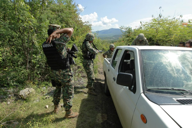 Mexican soldiers control access to the site where authorities found a mass grave, in Iguala, Guerrero, Mexico, Oct. 5. 43 Mexican youths have been missing since 27 September.