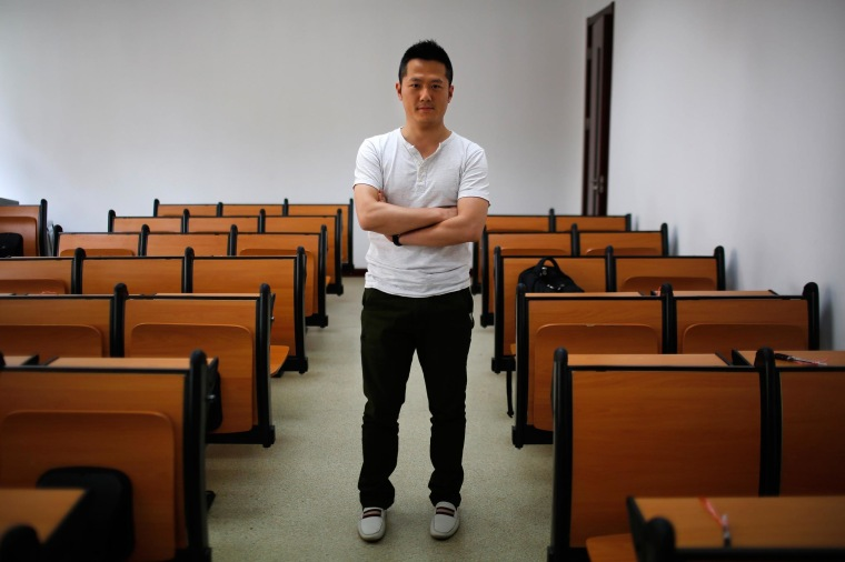 Image: Cai Hua, who was born in 1979, poses for a photograph in Shanghai