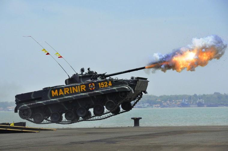 Image: A Tank Firing Mid-Jump