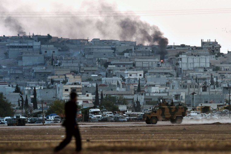 Image: Smoke rises from the city centre of the Syrian town of Ain al-Arab